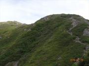 一足先に聖岳山頂を目指す彼